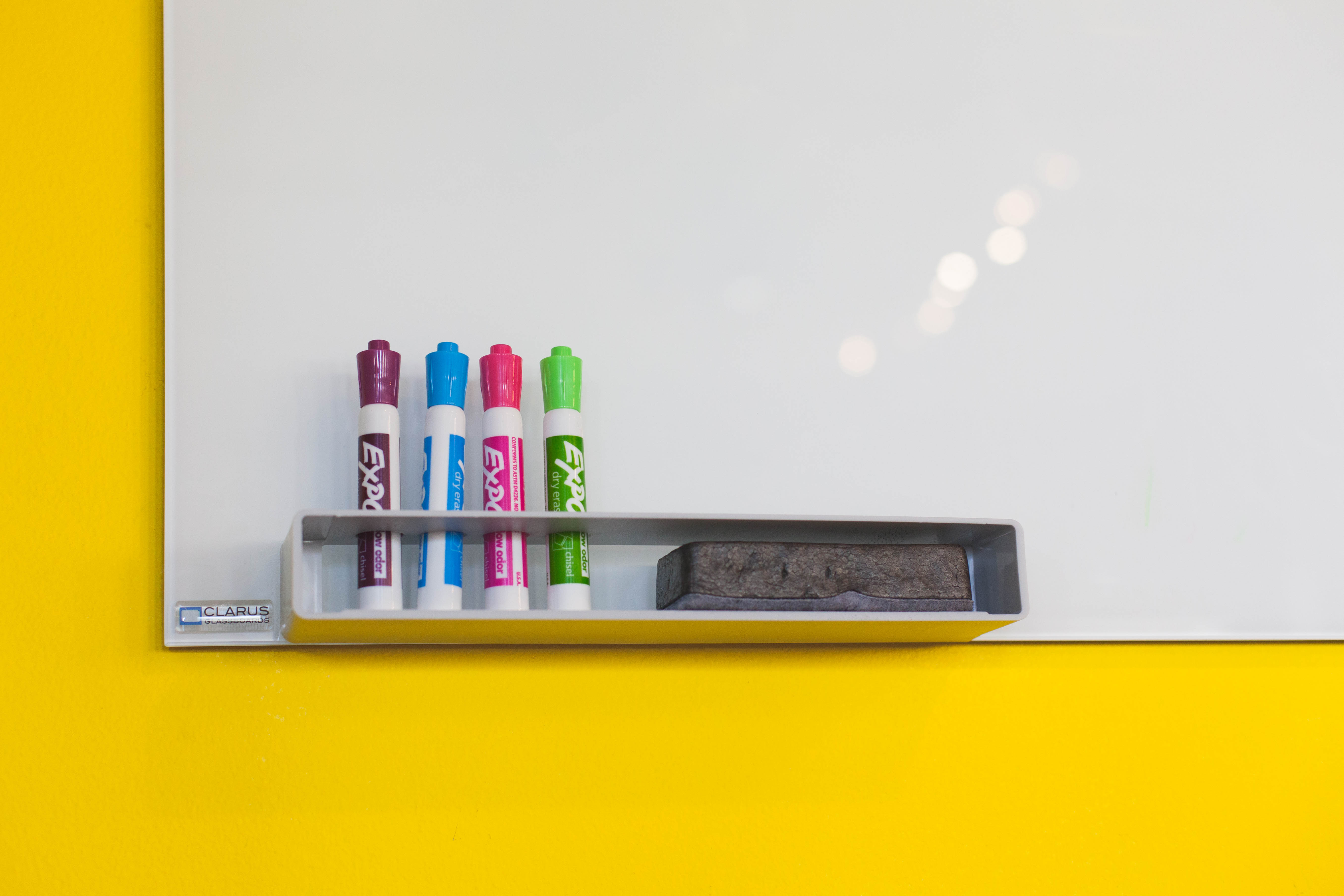 dry erase board with colorful markers